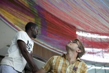 Intern Claude Moussoki and Benjamin Ball examine Gravity's Loom; photo by IMA photographer Hadley Fruits.