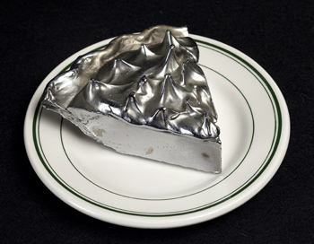 "Robert Watts, Chocolate Cream Pie, 1964, Aluminum, 2 ½"" x 5"" x 5"", Courtesy of the Jane Voorhees Zimmerli Art Museum, Rutgers, The State University of New Jersey. Gift of Bernard and Florence Galkin."