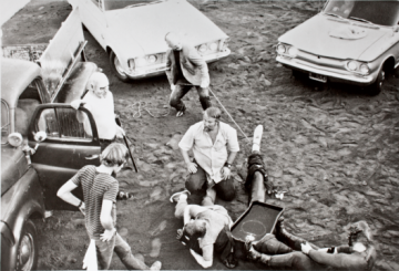 Kienholz and his team installing Five Car Stud in the parking lot of Gemini G.E.L. in Los Angeles © Kienholz, photographs by John Romeyn, Bob Bucknam, Malcolm Lublinder, and Adam Avila, 1971