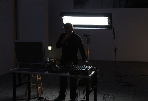 "Terence Hannum in Terence Hannum and Nicolas Lobo's ""Broadcast Against Recording"" performance event at de la Cruz Collection, Miami, Fl, United States, July 9, 2011"