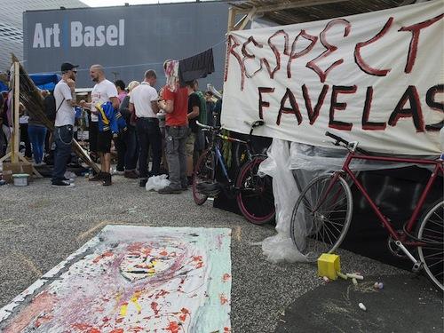 """Occupation of Tadashi Kawamata's """"Favela Café"""" outside Art Basel, 2013."""