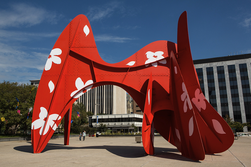 David Dodde, Fleurs et Riviere, 2013; 43 x 54 x 30 ft. La Grande Vitesse (Alexander Calder, 1969) as substrate; 1,500 magnets, 18 flowers and 39 leaves, hand-cut. Photo: Brian Kelly