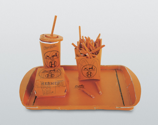"Tom Sachs. ""Hermés Value Meal,"" 1997. Cardboard, thermal adhesive; 15.35 x 7.87 x 7.87 inches."