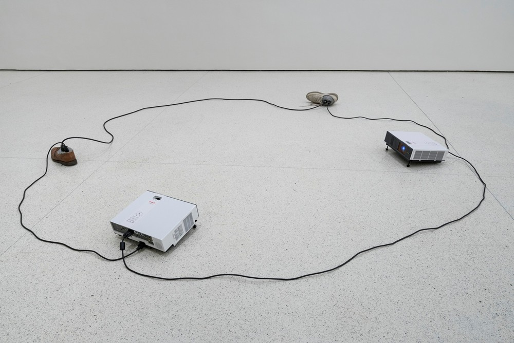 "Paul Chan, ""Sock N Tease"", Concrete, cords, shoes, and video projectors with digital color video, silent, 2013 Courtesy the artist and Greene Naftali, New York"