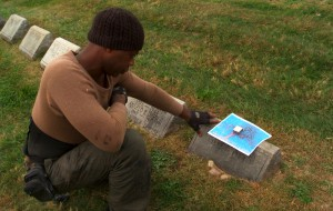 Leonardo Drew visiting the grave of Piet Mondrian in Cypress Hills Cemetery, Brooklyn. Production still from the series ART21 Exclusive. © ART21, Inc. 2015.  Cinematography: Joel Shapiro.