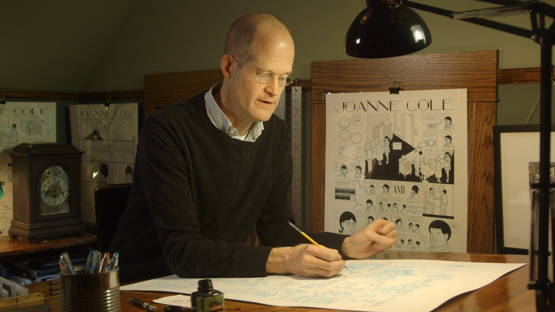 Chris Ware in his studio in Oak Park, USA, 2016. Production still from ART21's series Art in the Twenty-First Century, Season 8, 2016. Cinematography: Keith Walker. © ART21, Inc. 2016.