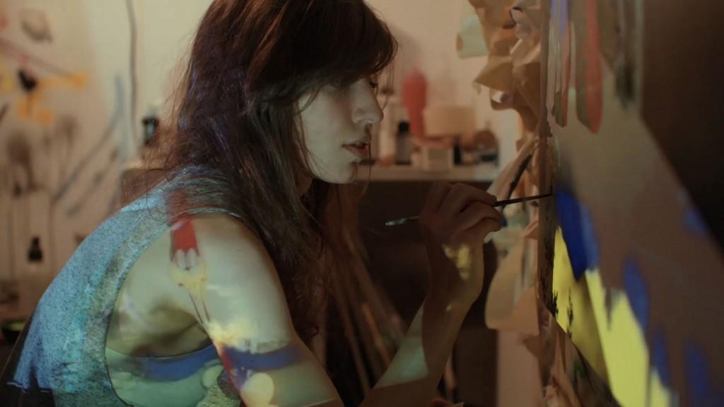 "Artist Jamian Juliano-Villani in her Bedford-Stuyvesant studio, Brooklyn, NY, 2015. Production still from the ART21 ""New York Close Up"" film ""Jamian Juliano-Villani's Painting Compulsion"". © ART21, Inc. 2015."