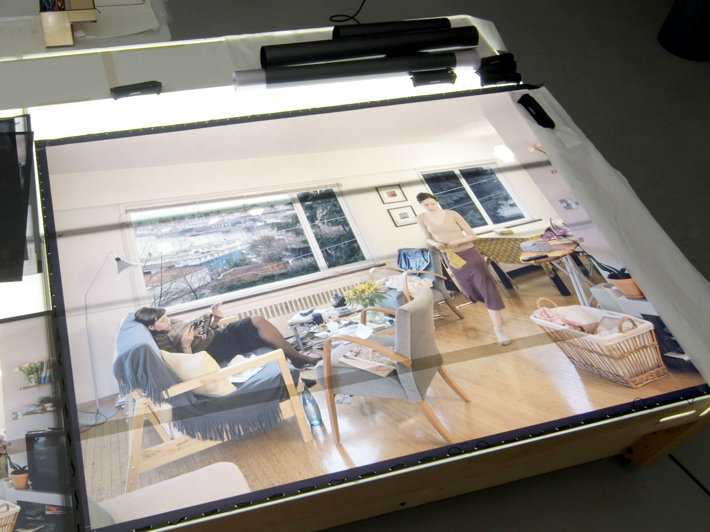 "Transparencies of #JeffWall's ""A view from an apartment"" (2004–05) on a lightbox at the artist's Vancouver studio, as featured in a preview on art21.org from #ART21's upcoming new broadcast season. Production still from ART21's series Art in the Twenty-First Century, Season 8, 2016. © ART21, Inc. 2016."